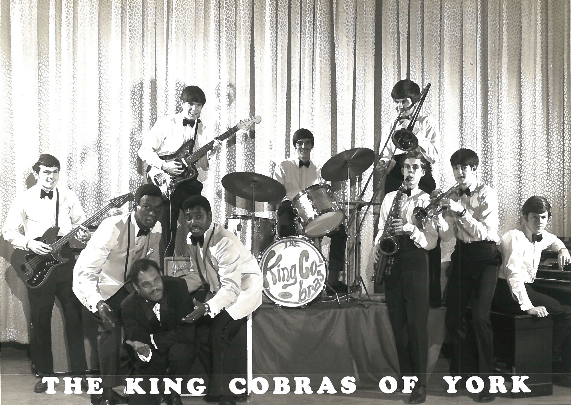 A group photo of the King Cobras of York soul cover band.