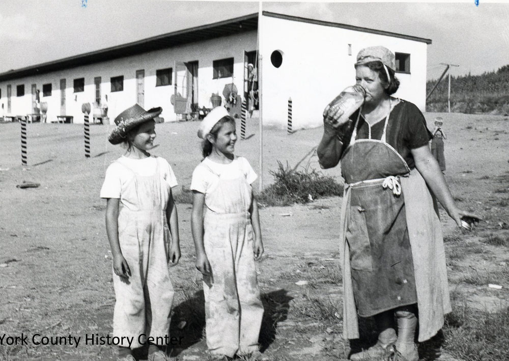 """Typical migrant workers,"" Mrs. Jessie Jakelski and twin nine-year-olds, Bernadine and Veronica."