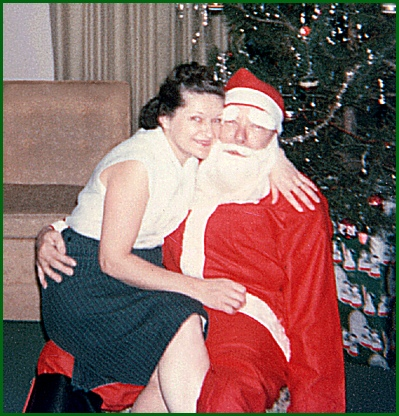 Photo of Esther L. Smith and Santa (her husband Harold L. Smith) at the Smith Home on Christmas Eve 1962 (1962 Photo by S. H. Smith)