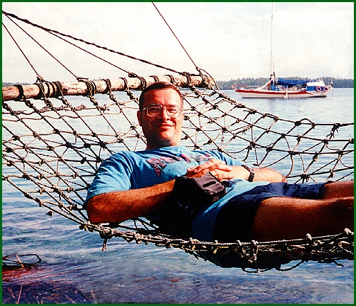 Stephen H. Smith on a Hammock over the Lagoon of Palmyra Island (Passenger Photo; Sept. 14, 1994)