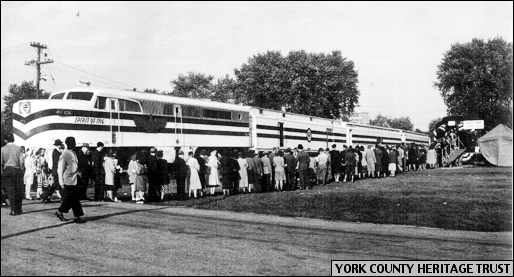 Queue of Yorkers waiting to visit York's Car of Documents and Artifacts, while standing next to Freedom Train within the York Fairgrounds, York, PA, on October 10, 1948 (Photo from Collections of York County Heritage Trust)