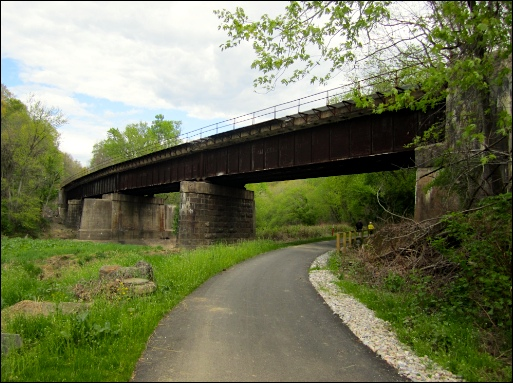Eastward View of the Hertiage Rail Trail County Park, as it passes under Black Bridge (S. H. Smith, 2015)