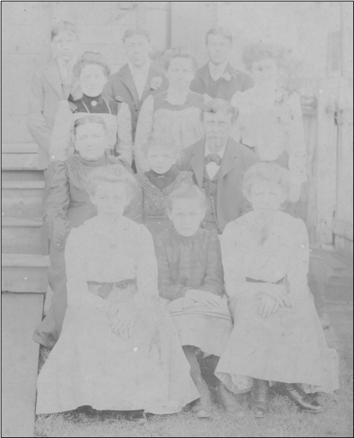 Faded Photo containing Names of the Family of Mr. & Mrs. John D. Gilbert written on the back (Collections of Shirley Keeports)