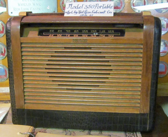 This 1940s Philco looks a little more portable.  It is still wood, but has grained leather trim and a leather strap handle.