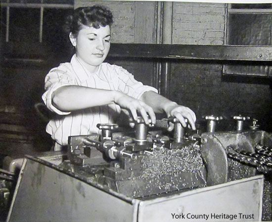 Unidentified young woman doing metal work in York County World War II factory