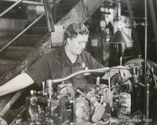 "The original caption reads:  ""Mrs Marie Green,  56, Grandmother,  Martin's Engine Parts [for]   Martin Cargo Ship (Corvette)"""