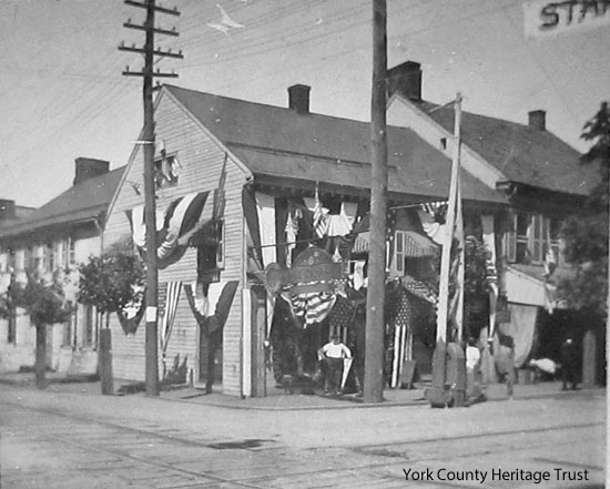 Before--buildings at Market and Water (later Pershing) in 1918, decorated for end of World War I