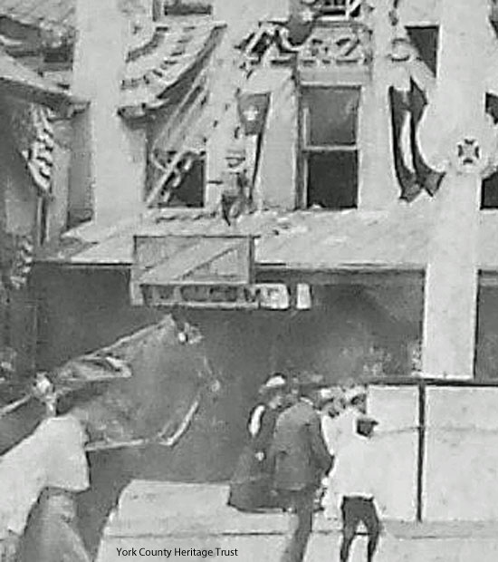 This image is cropped from a 1904 photo of still another parade.  Punch is in the same general area as before, but he has been raised higher to roof/canopy level.