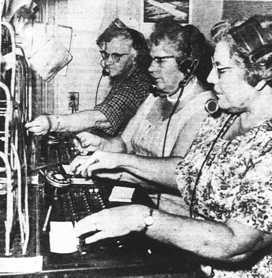 Stewartstown telephone operators retired when this hand-operated magneto switchboard went out of service and an automatic exchange began operating yesterday at 3:01 a.m. The three operators pictured are, from foreground to background, Mrs. Grace Tarbet, who worked the switchboard eight years, Mrs. Ruth Miller, who has 14 years of service, and Thelma Kerlinger, an operator for nine years. There were six other operators. No longer will a Stewartstown subscriber be able to ask an operator for the special accommodation of routing a call to some nearby place where that subscriber would be visiting. Other operators and their years of service are: Mrs. Evelyn Manifold, chief operator, 27; Mrs. Joyce McClaister, three; Mrs. Mildred Zeigler, four; Mrs. Eva Webb, night operator, five; and Luella Snyder, one.