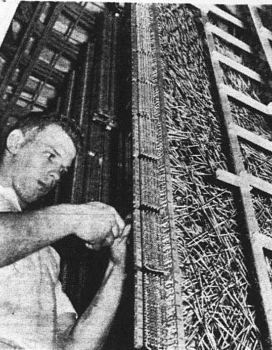 Wires, thousands of them, twist and wind through the automatic equipment in the new exchange. The worker is Robert E. Shaull, Brogueville RD 1, an employee of General Telephone and Electronics corporation, which acquired York Telephone in 1959.