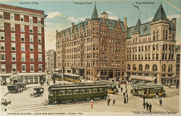 The Schmidt/Rupp building is to the right of the similar Colonial Hotel