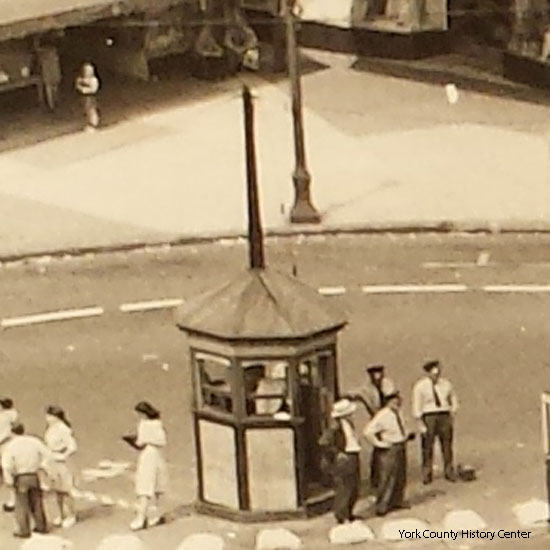 This 1946 photo shows the kiosk with a peaked roof and large pole, probably an antenna for the bus dispatcher.