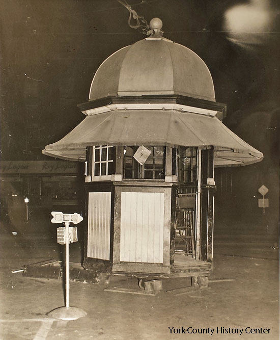 The kiosk is being moved for some reason, about 1940.  Note the fancy fabric awning.