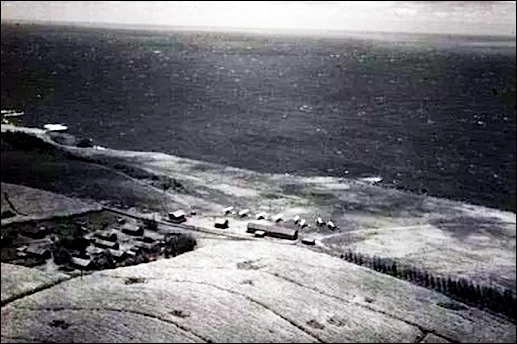 Landing field on the northern tip of the big island in Hawaii was named Suiter Field in honor of First Lieutenant Wilbur C. Suiter, and is now the site of Upolu Airport. (Government of Hawaii photo from 1933)