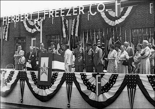 "Speaker's platform at the H. J. Freezer Company plant in Spring Garden Township, York County, PA (June 27, 1944 presentation of Army-Navy ""E"" Award; photo in Collection of York County History Center)"