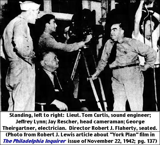 "Standing, left to right: Lieut. Tom Curtis, sound engineer; Jeffrey Lynn; Jay Rescher, head cameraman; George Theirgartner, electrician.  Director Robert J. Flaherty, seated.  (Photo from Robert J. Lewis article about ""York Plan"" film in The Philadelphia Inquirer, issue of November 22, 1942; page 137.)"