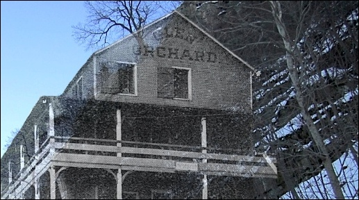 Photo ghosts an image of the upper floors of the Glen Orchard onto a photo of the exact spot in Hellam Township where that hotel once stood (Glen Orchard image from circa 1906 postcard in collections of S. H. Smith; ghosted over photo along River Drive in Hellam Township, York County, PA. S. H. Smith, 2019)