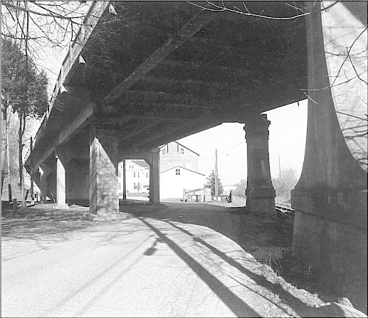 1998 eastward looking photo of the Stony Brook humpback bridge in Springettsbury Township, York Co., PA; prior to its demolition during Summer of 1998.  (Source: Springettsbury Township Historic Preservation Committee Archives)