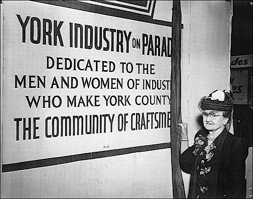 Miss Virginia Ruth, still actively on the job for over 60-years at P. H. Glatfelter Company, is given the honor of unveiling a dedication plaque to her fellow men and women of industry who make York County the Community of Craftsmen (Sept. 13, 1949 photo in Collection of York County History Center)